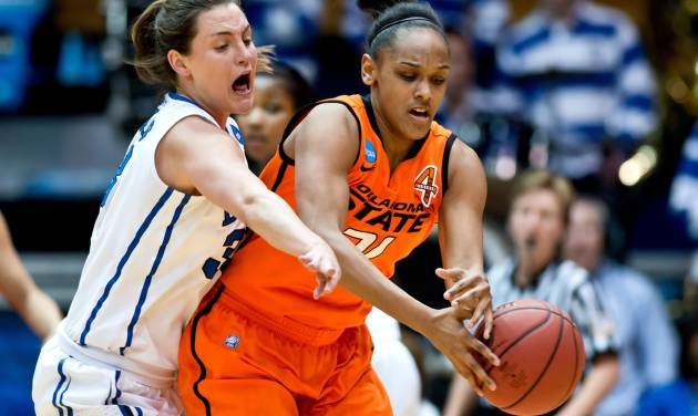 Duke's Haley Peters (33) and Oklahoma State's Kendra Suttles (31) fight for a loose ball during the first half in the women's NCAA Tournament at Cameron Indoor Stadium in Durham, North Carolina, Tuesday, March 26, 2013. (Greg Mintel/Raleigh News & Observer/MCT)