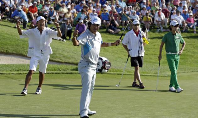 Hideki Matsuyama, foreground, of Japan, celebrates after winning the Memorial golf tournament in a playoff on Sunday, June 1, 2014, in Dublin, Ohio. (AP Photo/Darron Cummings)