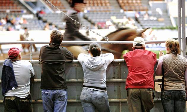 Trainers watch a rider and horse compete in a recent show at State Fair Arena. OKLAHOMAN ARCHIVE PHOTO BY JIM BECKEL