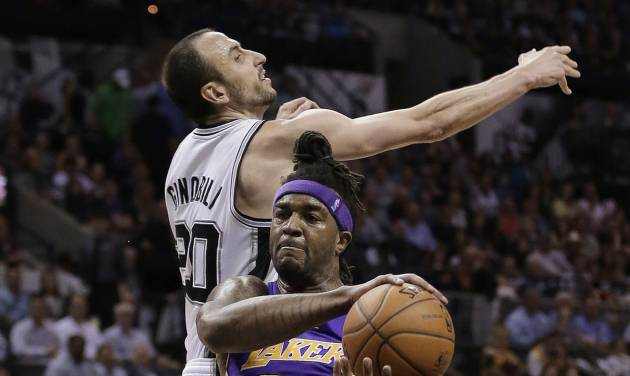 Los Angeles' Jordan Hill (27) pulls down a rebound next to San Antonio Spurs' Manu Ginobili (20), of Argentina, during the first half of an NBA basketball game, Wednesday, April 16, 2014, in San Antonio. (AP Photo/Eric Gay)