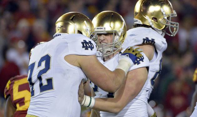 Notre Dame kicker Kyle Brindza, center, celebrates with offensive tackle Nick Martin after kicking a field goal during the second half of an NCAA college football game against Southern California, Saturday, Nov. 24, 2012, in Los Angeles. Notre Dame won 22-13. (AP Photo/Mark J. Terrill) ORG XMIT: LAC114