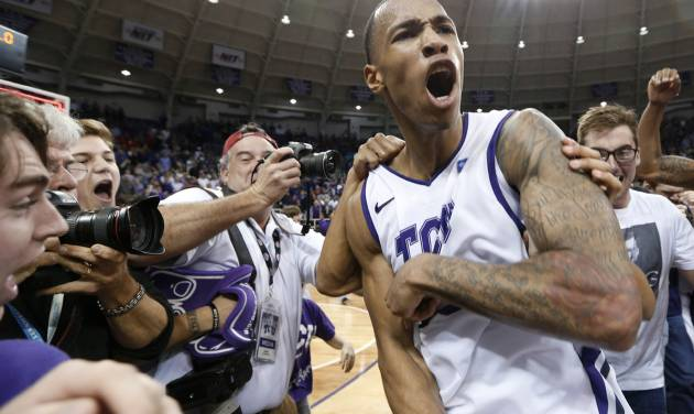 TCU forward Garlon Green celebrates with the fans on the court after an NCAA college basketball game against Kansas on Wednesday, Feb. 6, 2013, in Fort Worth, Texas. TCU won 62-55. (AP Photo/Sharon Ellman)