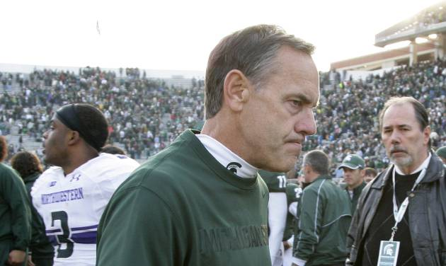 Michigan State coach Mark Dantonio walks off the field following a 23-20 loss to Northwestern in an NCAA college football game, Saturday, Nov. 17, 2012, in East Lansing, Mich. (AP Photo/Al Goldis)