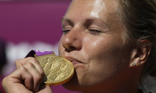 Esther Vergeer of the Netherlands kisses her gold medal for winning the women's wheelchair tennis final at the 2012 Paralympics games, Friday, Sept. 7, 2012, in London. Vergeer defeated Aniek Van Koot in the final 6-0, 6-4.(AP Photo/Alastair Grant)