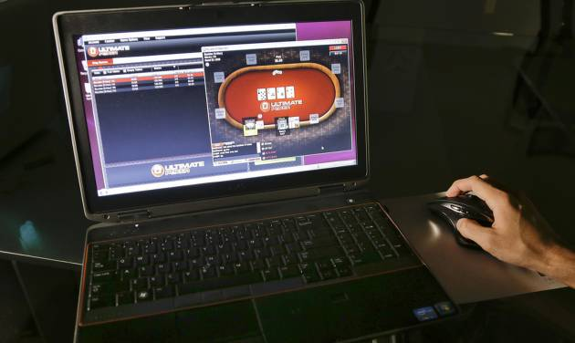 FILE - In this Monday, April 29, 2013, file photo, a sample poker game is played on the Ultimate Gaming website, in Las Vegas. Ultimate Gaming began offering Internet gambling in Nevada earlier this year, and now New Jersey residents and visitors will be able to start gambling online on Nov. 26, after a five-day trial period to make sure the systems operated by the city's 12 casinos work properly. Nine of the city's 12 casinos have acknowledged lining up partners for Internet gambling, and a 10th is widely rumored to have selected a partner, as well. (AP Photo/Julie Jacobson, File)