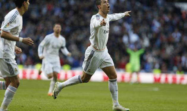 Real Madrid's Cristiano Ronaldo, right, celebrates his goal during a Spanish La Liga soccer match between Real Madrid and Granada at the Santiago Bernabeu stadium in Madrid, Spain, Saturday, Jan. 25, 2014. (AP Photo/Andres Kudacki)