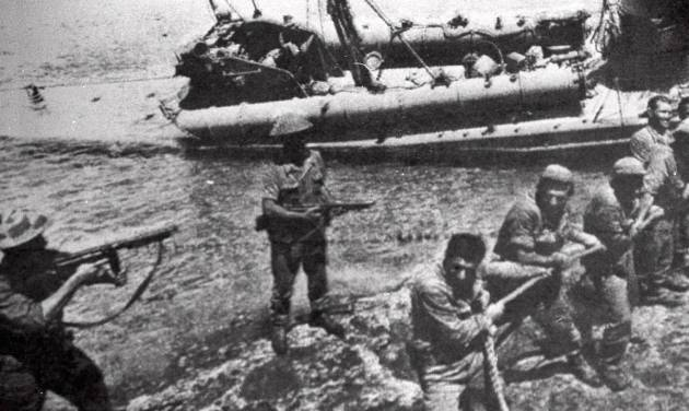 FILE- In this file photo dated July 20 1974, Turkish troops pull ashore a Greek Cypriot torpedo boat damaged during fighting in Kyrenia on the day Turkey invaded and occupied the northern third of Cyprus.  Europe's top human rights court on Monday May 12, 2014, ordered Turkey to pay 90 million euros ($123 million) to Cyprus over the 1974 invasion of the island and its subsequent division, in one of the largest judgments in its history, saying that the passage of time did not erase responsibility in the case. The judgment comes as the Turkish and Greek Cypriot communities are engaged in renewed efforts to reunite the island.(AP Photo, FILE)