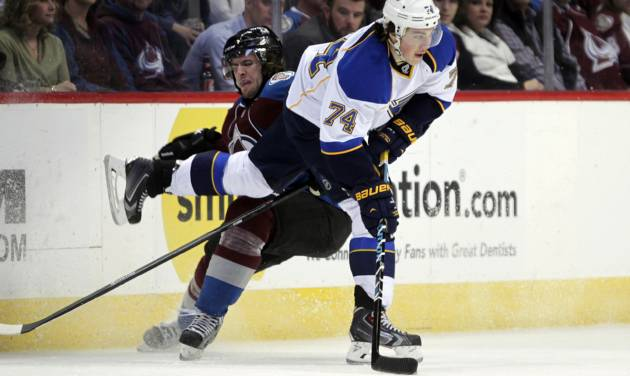 Colorado Avalanche defenseman Jan Hejda (8) checks St. Louis Blues right wing T.J. Oshie (74) during the first period of an NHL hockey game in Denver, Wednesday, Nov. 27, 2013. (AP Photo/Joe Mahoney)