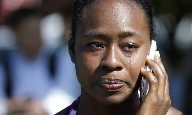 Brianna Clarke, a student at Seattle Pacific University, cries as she talks on her phone at the scene of a shooting Thursday, June 5, 2014 at Seattle Pacific University in Seattle. About 4,270 students attend the private Christian university, located in a residential neighborhood about 10 minutes from downtown Seattle. (AP Photo/Ted S. Warren)