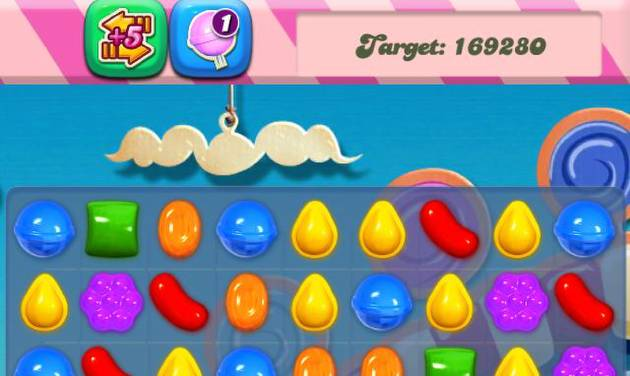 This undated screenshot shows Candy Crush Saga,  the maddeningly addictive mobile game that involves matching bright-hued virtual candies in a row to have them disappear, only to be replaced by more. (AP Photo/Candy Crush)