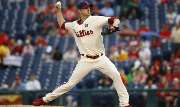 Philadelphia Phillies' Kyle Kendrick pitches during the first inning of a baseball game against the San Diego Padres, Thursday, June 12, 2014, in Philadelphia. (AP Photo/Matt Slocum)