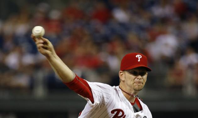 Philadelphia Phillies' A.J. Burnett pitches during the third inning of a baseball game against the Washington Nationals, Monday, Aug. 25, 2014, in Philadelphia. (AP Photo/Matt Slocum)