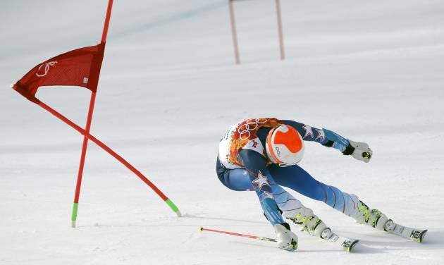 United States' Bode Miller passes a gate in the first run of the men's giant slalom at the Sochi 2014 Winter Olympics, Wednesday, Feb. 19, 2014, in Krasnaya Polyana, Russia. (AP Photo/Christophe Ena)