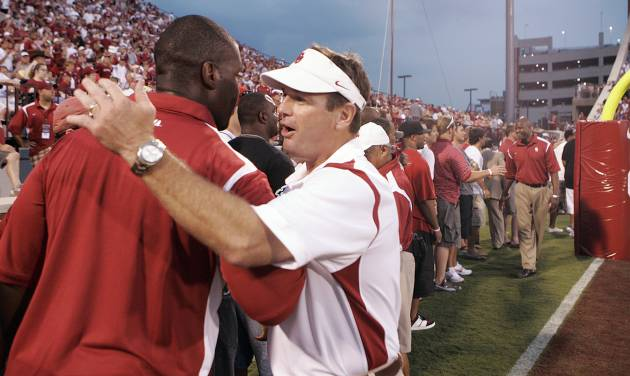 Head coach Bob Stoops shakes hands with more than 100 of his former players during a half time celebrations of Stoops' tenth year as the Sooners' head coach during the college football game between the University of Oklahoma Sooners (OU) and University of Tennessee-Chattanooga Mocs (UTC) at the Gaylord Family -- Oklahoma Memorial Stadium on Saturday, Aug. 30, 2008, in Norman, Okla.   Staff Photo by Steve Sisney/The Oklahoman ORG XMIT: KOD