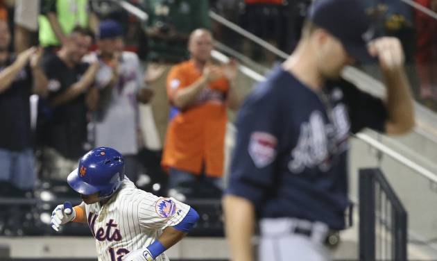CORRECTS TO TWO-RUN HOME RUN  - New York Mets' Juan Lagares (12) rounds third base after hitting a two-run home run off of Atlanta Braves starting pitcher Alex Wood in the fourth inning of a baseball game Tuesday, Aug. 26, 2014, in New York. (AP Photo/John Minchillo)