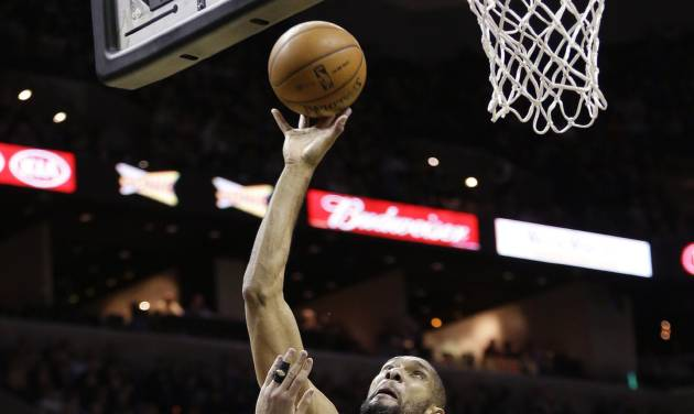 San Antonio Spurs' Tim Duncan (21) shoots over Memphis Grizzlies' Marc Gasol (33) during the second quarter of an NBA basketball game, Wednesday, Jan. 16, 2013, in San Antonio. (AP Photo/Eric Gay)