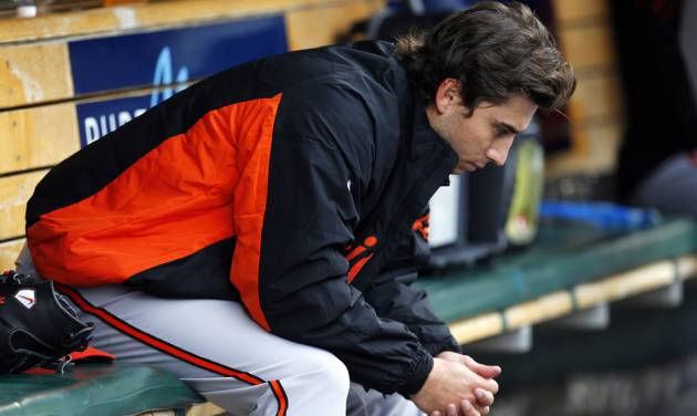 Baltimore Orioles pitcher Miguel Gonzalez sits in the dugout after being pulled in the fourth inning of a baseball game against the Detroit Tigers in Detroit, Friday, April 4, 2014. (AP Photo/Paul Sancya)