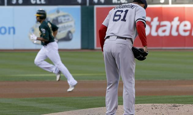 Oakland Athletics' Coco Crisp (4) rounds the bases after hitting a solo home run off of Boston Red Sox starting pitcher Felix Doubront (61) in the first inning of a baseball game Saturday, Sept. 1, 2012 in Oakland, Calif. (AP Photo/Tony Avelar)