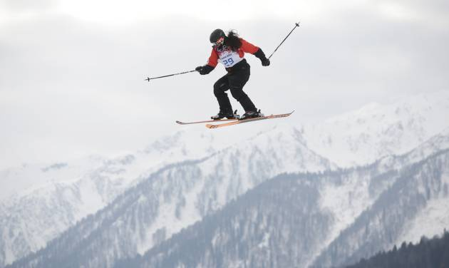 Paraguay's Julia Marino takes a jump during the women's freestyle skiing slopestyle qualifying at the Rosa Khutor Extreme Park, at the 2014 Winter Olympics, Tuesday, Feb. 11, 2014, in Krasnaya Polyana, Russia. (AP Photo/Jae C. Hong)
