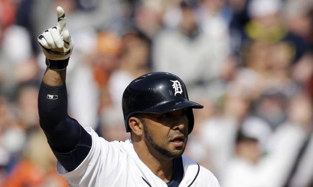Detroit Tigers' Alex Gonzalez signals after lining a single driving in the winning run during the ninth inning of a baseball game against the Kansas City Royals in Detroit, Monday, March 31, 2014. (AP Photo/Carlos Osorio)