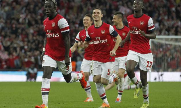 Arsenal's players celebrate their win against Wigan Athletic at the end of their English FA Cup semifinal soccer match at Wembley Stadium in London, Saturday, April 12, 2014. (AP Photo/Sang Tan)