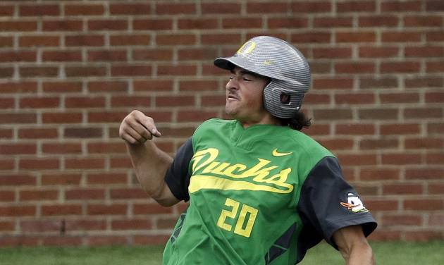 Oregon's Aaron Payne (20) celebrates after scoring against Xavier for Oregon's first run of the 10th inning during an NCAA college baseball regional tournament game on Sunday, June 1, 2014, in Nashville, Tenn. Oregon won 11-8 in 10 innings. (AP Photo/Mark Humphrey)