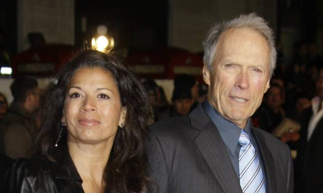 FILE - U.S Director Clint Eastwood, right, arrives with his wife, Dina on the red carpet for the UK premiere of Invictus at London's Leicester Square, in this Jan. 31, 2010 file photo. Eastwood's second wife has filed for legal separation from the actor and director. Dina Eastwood's petition filed in Monterey County Superior Court on Monday Sept. 9, 2013 seeks spousal support and physical custody of the couple's 16-year-old daughter, Morgan.(AP Photo/Joel Ryan, File)