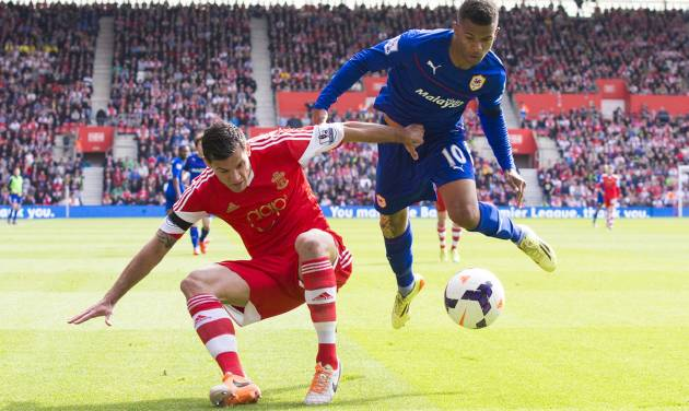 Southampton's Dejan Lovren, left, in action with Cardiff City's Fraizer Campbell during their English Premier League soccer match at St Mary's, Southampton, England, Saturday April 12, 2014. (AP Photo/PA, Chris Ison) UNITED KINGDOM OUT  NO SALES  NO ARCHIVE