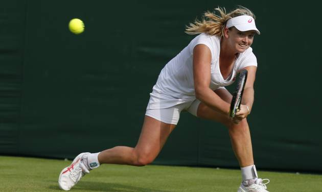 Coco Vandeweghe of the U.S. plays a return to Garbine Muguruza of Spain during their first round match at the All England Lawn Tennis Championships in Wimbledon, London,  Monday, June  23, 2014. (AP Photo/Sang Tan)