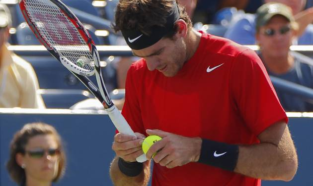 Argentina's Juan Martin Del Potro observes a ball to serve to Ryan Harrison in the third round of play at the 2012 US Open tennis tournament, Friday, Aug. 31, 2012, in New York. (AP Photo/Paul Bereswill)