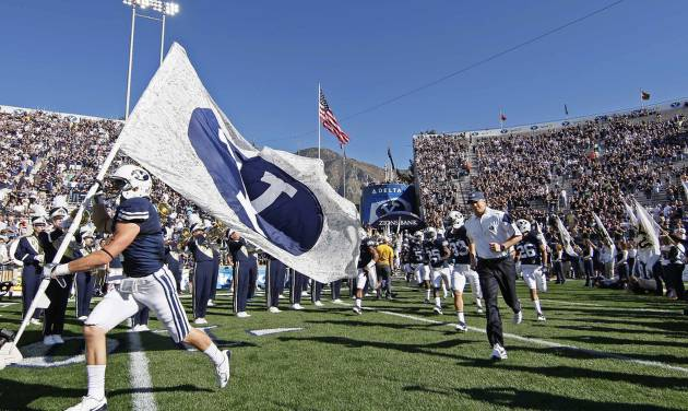 Bronco Mendenhall leads BYU onto the field. AP photo
