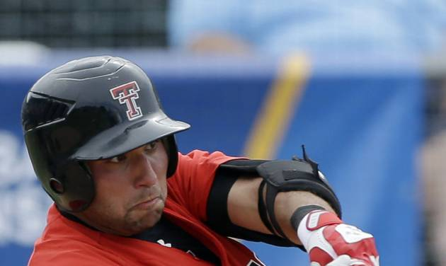 Texas Tech's Eric Gutierrez (12) doubles and drives in Zach Davis with the game-winning run against Columbia during the ninth inning of an NCAA college baseball regional tournament game in Coral Gables, Fla., Friday, May 30, 2014. Texas Tech won 3-2. (AP Photo/Alan Diaz)