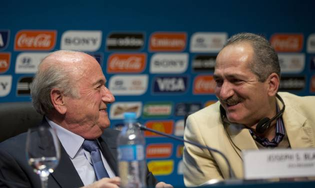 FIFA President Sepp Blatter, left, talks with Brazil's Sports Minister Aldo Rebelo during a press conference where they talked about the organization and infrastructure of the upcoming World Cup, in Sao Paulo, Brazil, Thursday, June 5, 2014. The World Cup soccer tournament starts on 12 June. (AP Photo/Andre Penner)