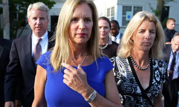 FILE- In this July 17, 2012 file photo, Kerry Kennedy, ex-wife of New York Gov. Andrew Cuomo, center, is flanked by her brother Christopher Kennedy, left, and sister Rory Kennedy as she walks from the North Castle Justice Court in Armonk, N.Y.  Jurors will hear Monday, Feb. 24, 2014, about Kerry's morning routine and daily medications as they consider whether she's guilty of drugged driving.  The case against Kennedy, daughter of the late Sen. Robert Kennedy, goes to trial Monday morning in suburban White Plains. In 2012, Kennedy was arrested after her car hit a tractor-trailer on an interstate highway near her home in the New York City suburbs. (AP Photo/Craig Ruttle, File)