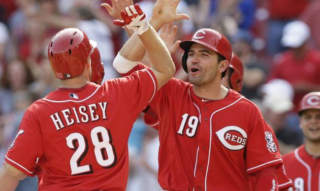 Cincinnati Reds' Chris Heisey (28) is congratulated by Joey Votto (19) after Heisey hit a pinch-hit grand slam off Tampa Bay Rays relief pitcher Josh Lueke in the eighth inning of a baseball game, Sunday, April 13, 2014, in Cincinnati. Cincinnati won 12-4. (AP Photo/Al Behrman)