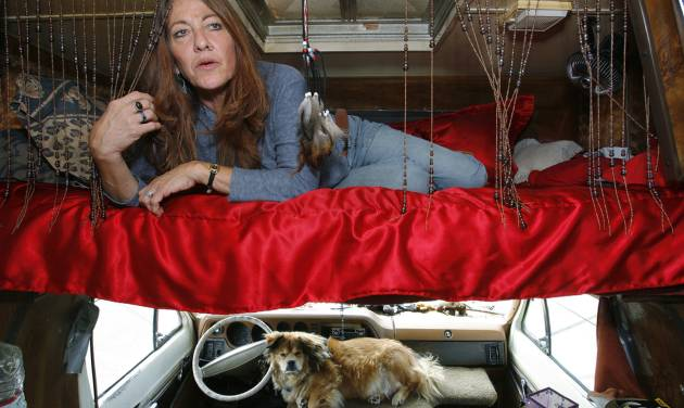 FILE - This June 4, 2008 photo shows Darlene Knoll, 53, resting in the sleeping area of the battered 1978 motor home where she lives in Los Angeles. A federal appeals court on Thursday, June 19, 2014, struck down a 31-year-old Los Angeles law that bars people from living in parked vehicles, saying the vaguely written statute discriminates against homeless and poor people. (AP Photo/Damian Dovarganes, file)