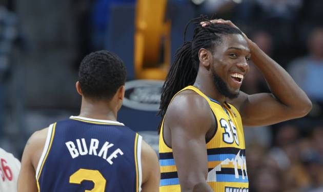 Denver Nuggets forward Kenneth Faried, right, smiles at teammates as he passes by Utah Jazz guard Trey Burke on the way to the foul line late in the fourth quarter of the Nuggets' 101-94 victory in an NBA basketball game in Denver on Saturday, April 12, 2014. Faried scored 24 points and collected 21 rebounds to notch the first 20-20 game of his career. (AP Photo/David Zalubowski)