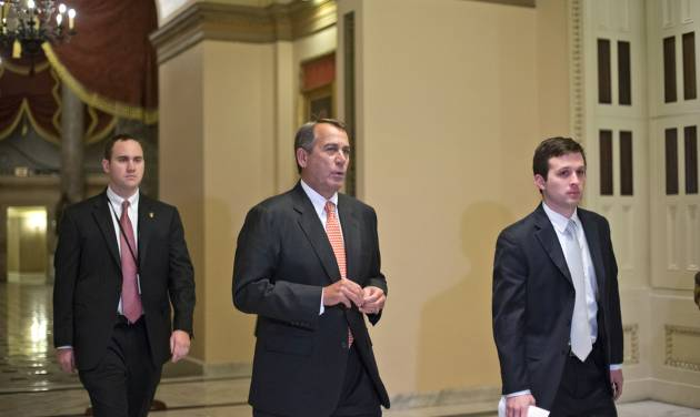 """Speaker of the House John Boehner, R-Ohio, walks to the House floor during a vote at the Capitol in Washington, Wednesday evening, Dec. 12, 2012. Boehner and the other House Republican leaders are calling for Obama to come up with plan they can accept for spending cuts and tax revenue to avoid the so-called """"fiscal cliff"""" of automatic tax hikes and budget reductions. (AP Photo/J. Scott Applewhite)"""