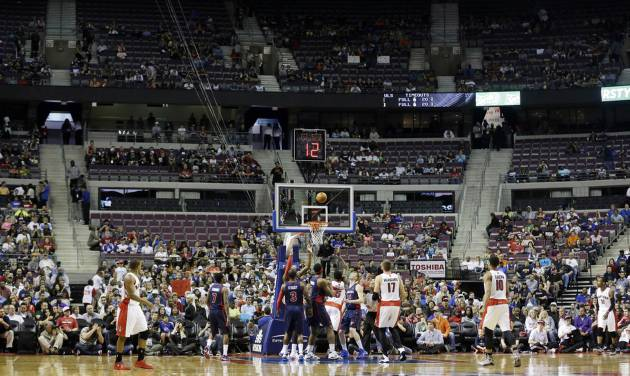 Empty seats are seen during the first half of an NBA basketball game between the Detroit Pistons and the Toronto Raptors in Auburn Hills, Mich., Sunday, April 13, 2014. (AP Photo/Carlos Osorio)