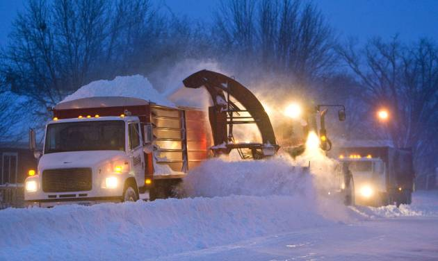 Snow clearing crews in Pine Island, Minn were out early trying to clear roads before morning commuters headed to work on Thursday, Dec. 20, 2012. The first major snowstorm of the season began its slow eastward march across the Midwest early Thursday, creating treacherous driving conditions and threatening to disrupt some of the nation's busiest airports ahead of the holiday weekend. (AP Photo/The Rochester Post-Bulletin, Jerry Olson)