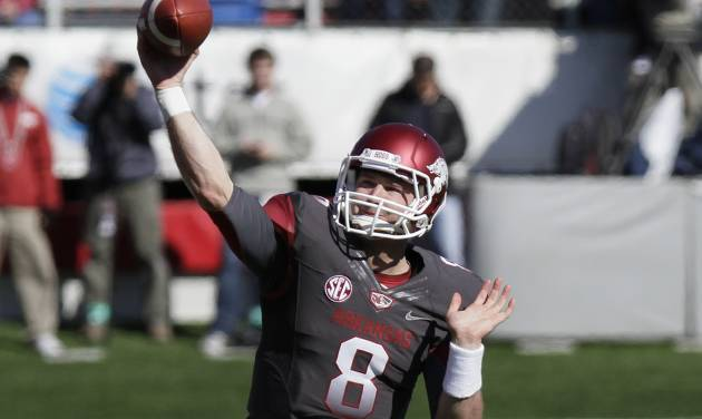 Arkansas quarterback Tyler Wilson passes during the first half of an NCAA college football game against Mississippi in Little Rock, Ark., Saturday, Oct. 27, 2012. (AP Photo/Danny Johnston)
