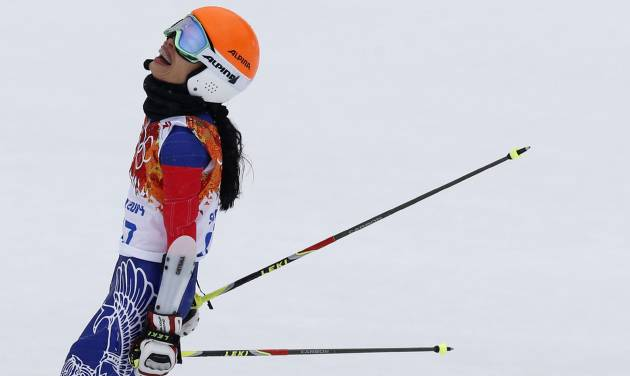 Violinst Vanessa Mae, starting under her father's name as Vanessa Vanakorn for Thailand, reacts after finishing the second run of the women's giant slalom at the Sochi 2014 Winter Olympics, Tuesday, Feb. 18, 2014, in Krasnaya Polyana, Russia.(AP Photo/Christophe Ena)