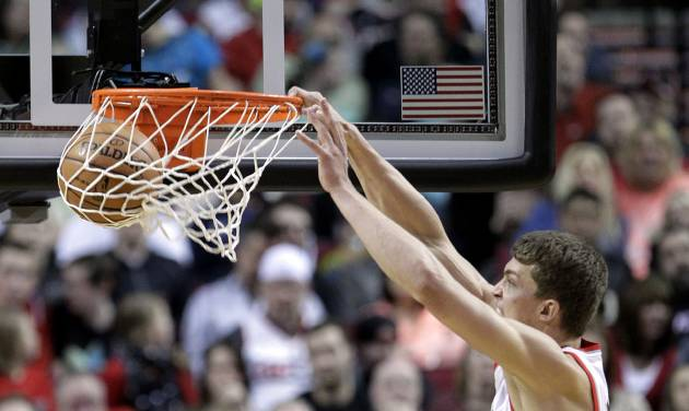 Portland Trail Blazers center Meyers Leonard, right, scores against Brooklyn Nets center Brook Lopez during the first quarter of an NBA basketball game in Portland, Ore., Wednesday, March 27, 2013. (AP Photo/Don Ryan)