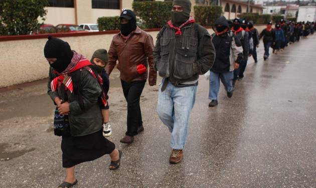 Masked Mayan Indians who are members of the Zapatista National Liberation Army (EZLN) march in line to the mayor's office in San Cristobal de las Casas, Chiapas state, Mexico, Friday, Dec. 21, 2012. On Friday, Zapatistas in several cities are marching to the city mayor's office for a gathering where they will listen to a message from their leaders. (AP Photo/Ivan Castaneira)