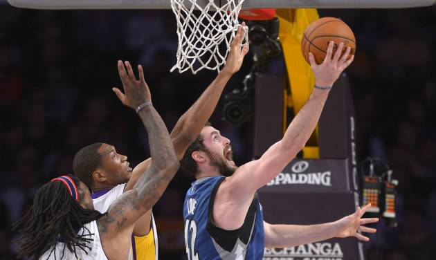 Minnesota Timberwolves forward Kevin Love, right, puts up a shot as Los Angeles Lakers center Jordan Hill, left, and guard Wesley Johnson defend during the first half of an NBA basketball game, Sunday, Nov. 10, 2013, in Los Angeles. (AP Photo/Mark J. Terrill)