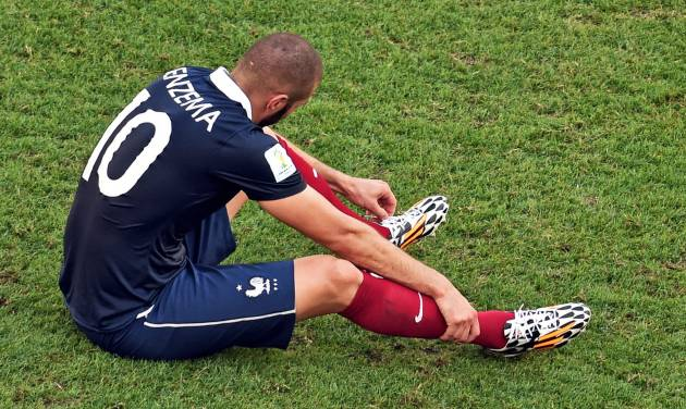 France's Karim Benzema sits on the pitch after the World Cup quarterfinal soccer match between Germany and France at the Maracana Stadium in Rio de Janeiro, Brazil, Friday, July 4, 2014. France lost 0-1. (AP Photo/Francois Xavier Marit, pool)