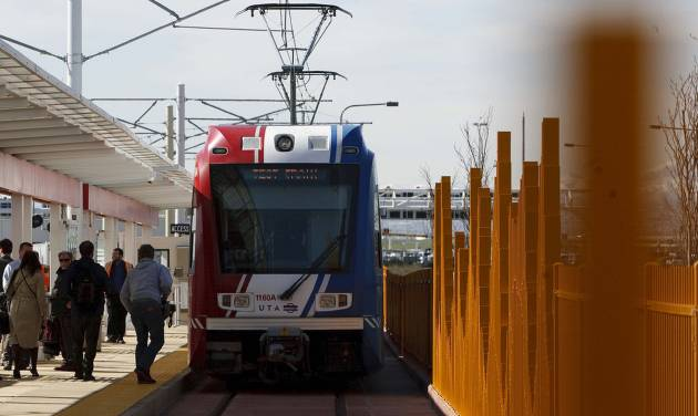 FILE - This April 10, 2013 photo shows passengers boarding a TRAX train at Salt Lake International Airport for the ride back into downtown Salt Lake City. The Utah Transit Authority is moving thousands of passengers a day on a 6-mile light-rail line to Salt Lake City International Airport from the city's downtown, with ridership exceeding expectations. About 4,800 people a day boarded the line from the downtown station during the first week of operation starting April 15, transit analysts said.(AP Photo/The Salt Lake Tribune, Leah Hogsten, file)  DESERET NEWS OUT; LOCAL TV OUT; MAGS OUT