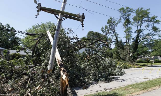 Trees lie in the middle of Lake Ave. in Baltimore on Monday July 2, 2012, after a severe storm swept through the region late Friday. Power outages left many to contend with stifling homes and spoiled food over the weekend as temperatures approached or exceeded 100 degrees.(AP Photo/Jose Luis Magana)