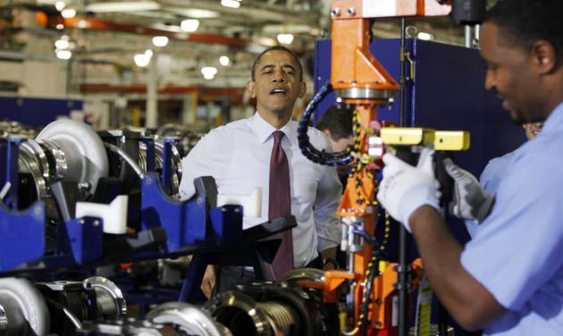 President Barack Obama watches a worker during a visit to the heavy duty engines line at the Daimler Detroit Diesel plant in Redford, Mich., Monday, Dec. 10, 2012. (AP Photo/Charles Dharapak)