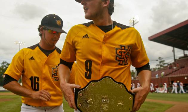 Kennesaw State's Will Lowman (16) helps winning pitcher Travis Bergen (9) adjust his championship belt after an NCAA college baseball tournament regionalgame against Alabama on Friday, May 30, 2014 in Tallahassee, Fla. Kennesaw State awards the belt to the player of the game when they win. Kennesaw State won 1-0. (AP Photo/Phil Sears)